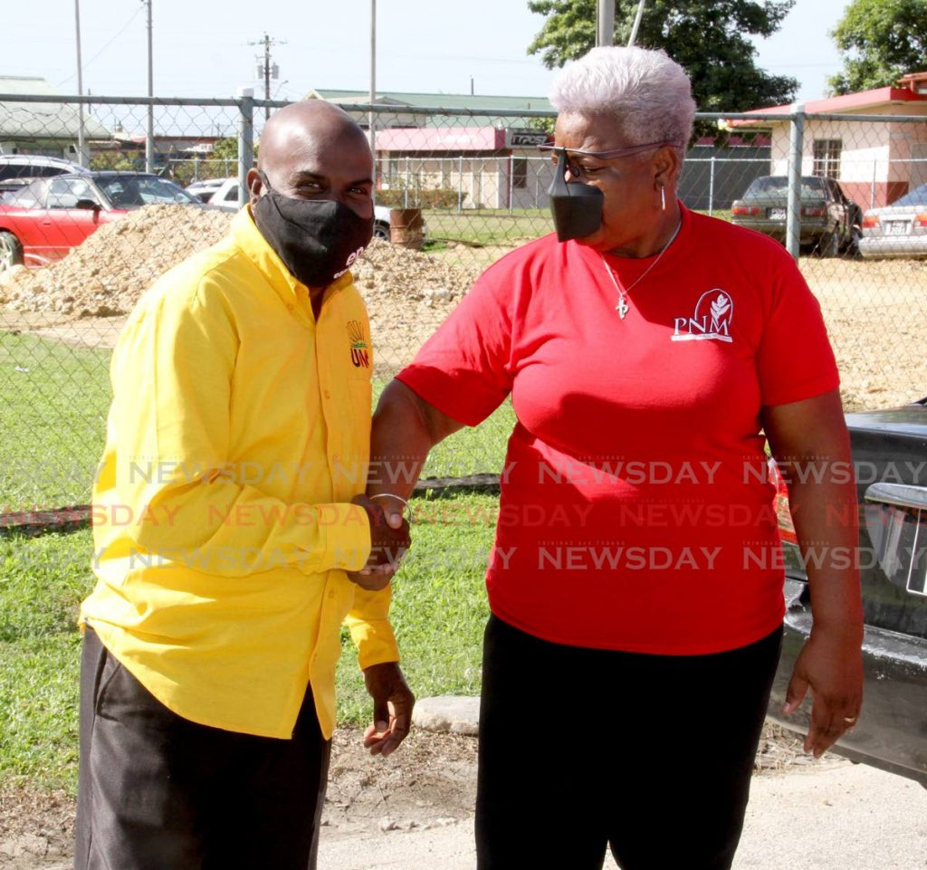 UNC and PNM candidates for Arima Central by-election, Sheldon 'Fish' Garcia and Dr Juliet Hilary Bernard, greet each other after filing their nomination papers at the La Horquetta Regional Complex on Monday morning.  - Angelo Marcelle