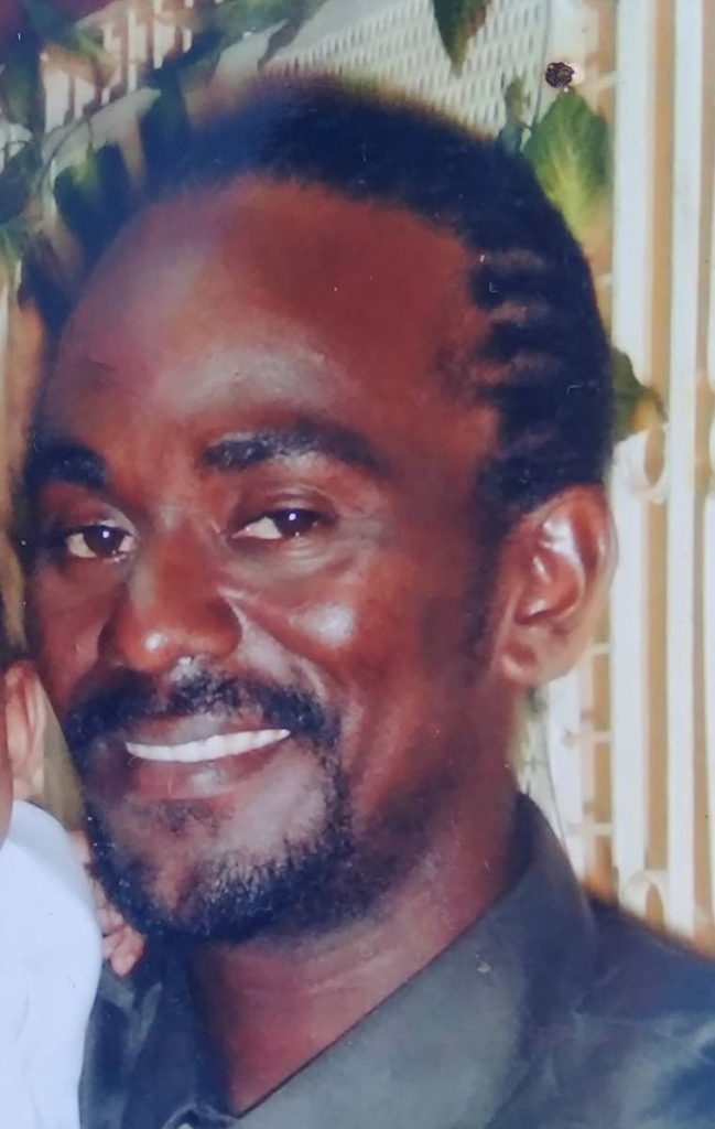 Darrel Villafana, 42, was chopped to death at his Geranium Drive, Morvant, home early on New Year's Day.  Relatives suspect he was killed by the ex-lover of a woman he recently began a relationship with.   PHOTO COURTESY VILLAFANA RELATIVES - PHOTO COURTESY VILLAFANA RELATIVES