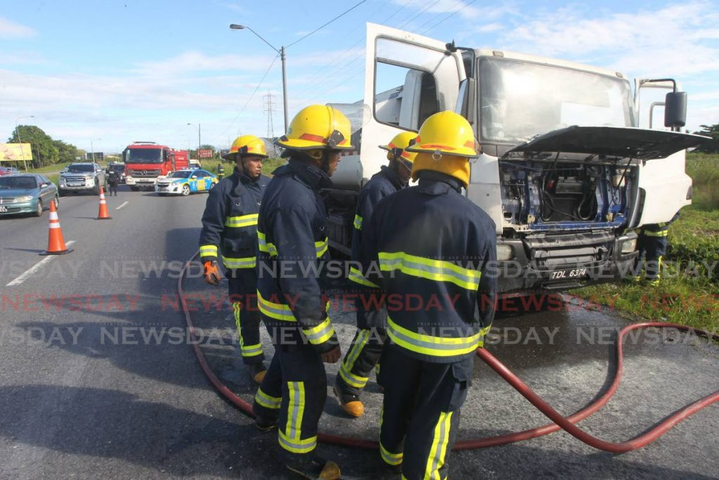 Fire officers from the Chaguanas fire station responded to a report of a gas tank wagon on fire along the south bound lane of the Solomon Hochoy highway near Chase village.The driver of the tanker, Bobbie Deokaran said he saw smoke coming from the engine and called the fire service. Photos by Lincoln Holder