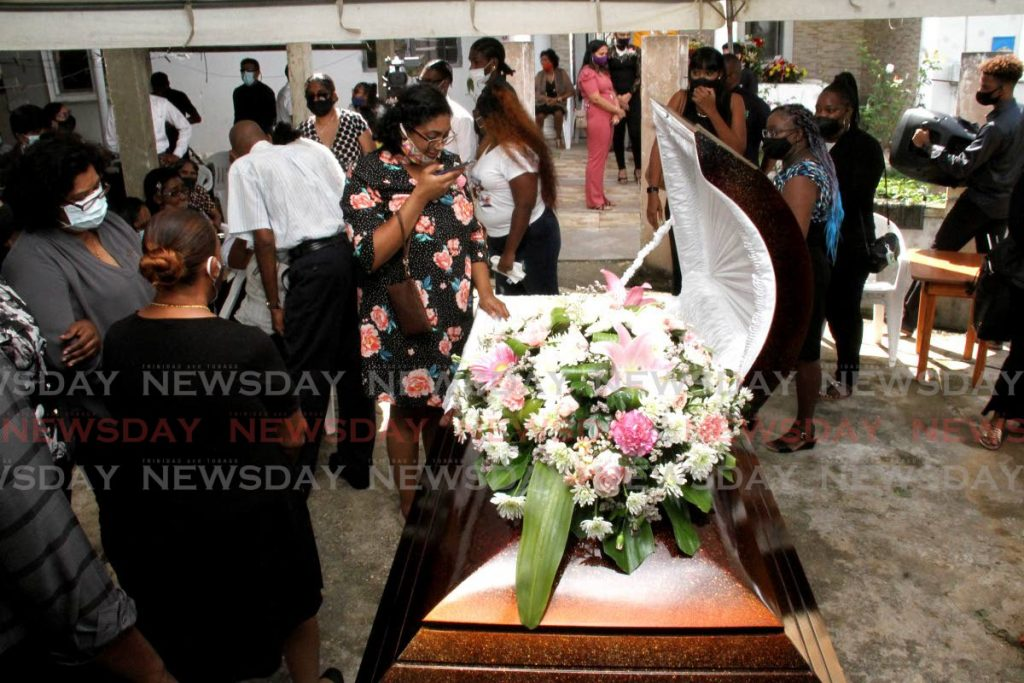 Seshal Sylveste, centre, mourns the death of her mother, school teacher Suzette Sylvester, at her funeral on Friday, Mowlah Road, Preysal. Suzette's husband was charged for her murder. - Angelo Marcelle