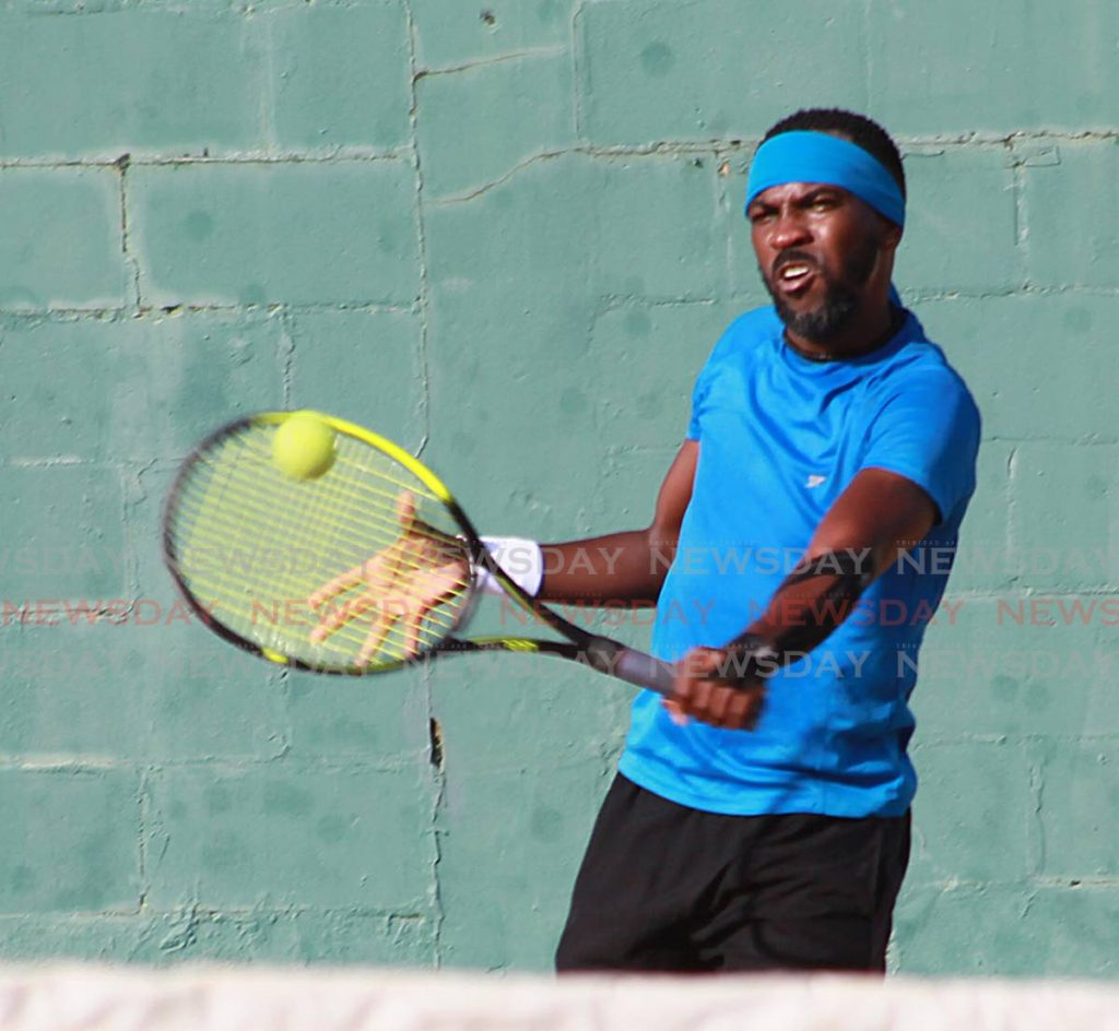 Kino Francis plays a backhand shot against Beckham Sylvester in the Shell Tranquillity Open Tennis tournament, on Friday. Francis lost to Richard Chung in the men's singles category, on Saturday.   - ROGER JACOB