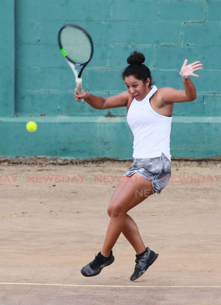 Carlista Mohammed in action during her women's singles semi-final match against Cameron Wong at the Shell Tranquility Open Tennis Tournament, at the Tranquility Tennis Courts, Port of Spain, on Sunday. PHOTO BY ROGER JACOB. - ROGER JACOB