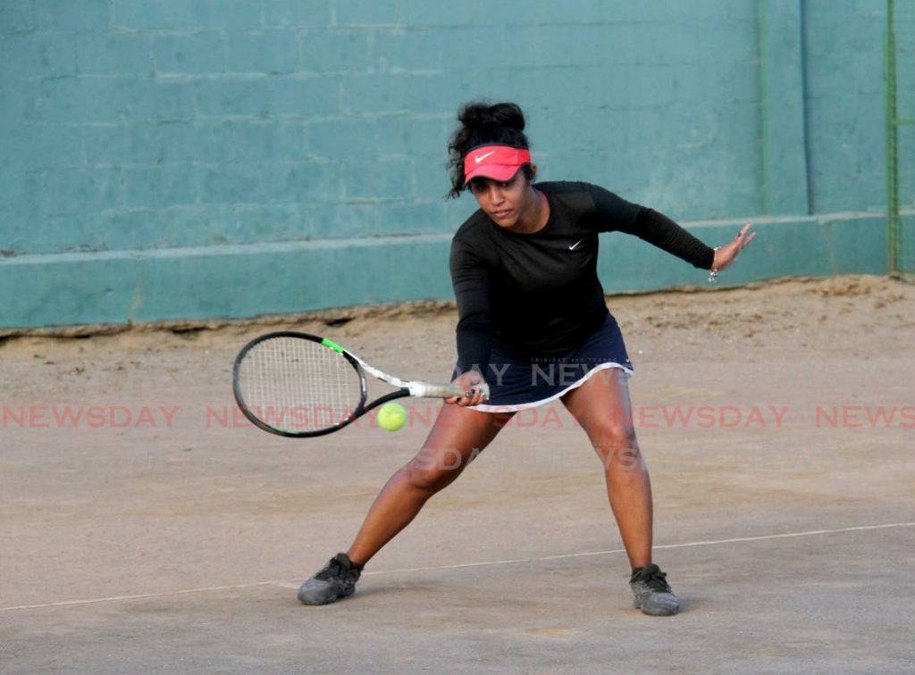 Carlista  Mohammed  returns the ball to Ella  Carrington during the women's  singles final of the Shell Tranquillity Open Tennis Tournament at the Tranquillity Tennis Courts, Port of Spain, on Monday.  Mohammed won 7-5,6-3.  - AYANNA KINSALE
