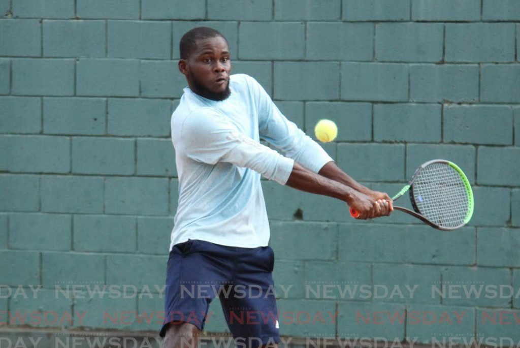 Vaughn Wilson makes a return to Akiel Duke, in the men's singles final, at the Shell Tranquility Open, at the Traquility Tennnis Courts, Port of Spain, on Tuesday. - Angelo Marcelle