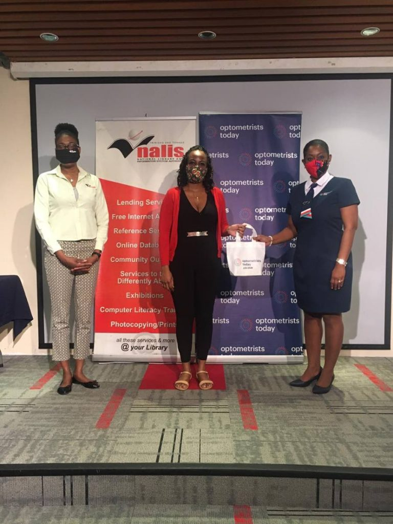 Lesley Johnson, one of the winners of the Nalis Celebrity Tale-A-Thon Spot the Logo Competition, receives her prize of designer sunglasses from Sonia King, assistant marketing manager, Optometrists Today. Looking on is Debbie Goodman, Nalis' manager, corporate communications.    -