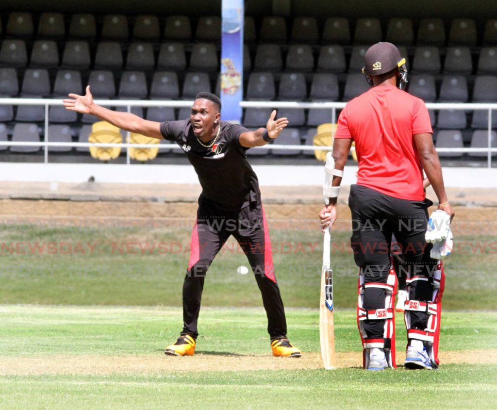 Imran Khan XI's  Dwayne Bravo, makes an LBW appeal against batsman Kieron Pollard, during a TT Red Force practice match,, at the Queen's Park Oval, Port of Spain on Wednesday. - Angelo Marcelle