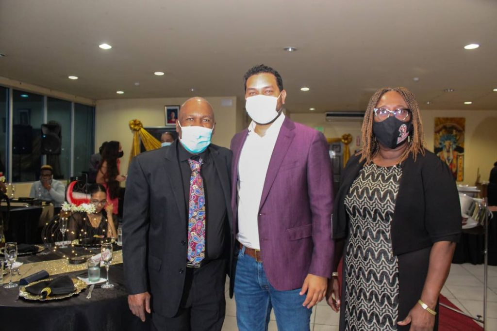 "Len ""Boogsie"" Sharpe, left,  with Minister of Tourism, Culture and the Arts Senator Randall Mitchell, centre and Pan Trinbago's president Beverley Ramsey-Moore, right. -"