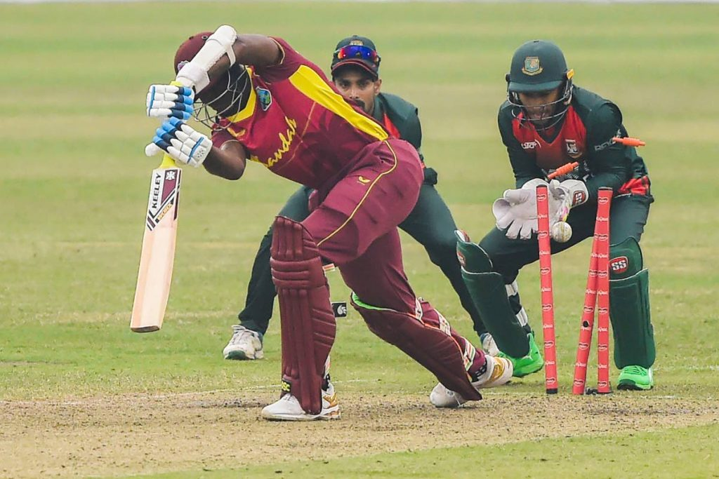 West Indies' Alzarri Joseph (L) is clean bowled off Bangladesh's Shakib Al Hasan during the first one-day international (ODI) at the Sher-e-Bangla National Cricket Stadium in Dhaka on Wednesday. (AFP PHOTO) -
