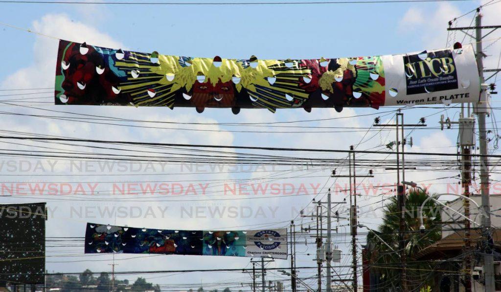 Newsday's graphic designer Warren Le Platte's work among the exhibits. - SUREASH CHOLAI