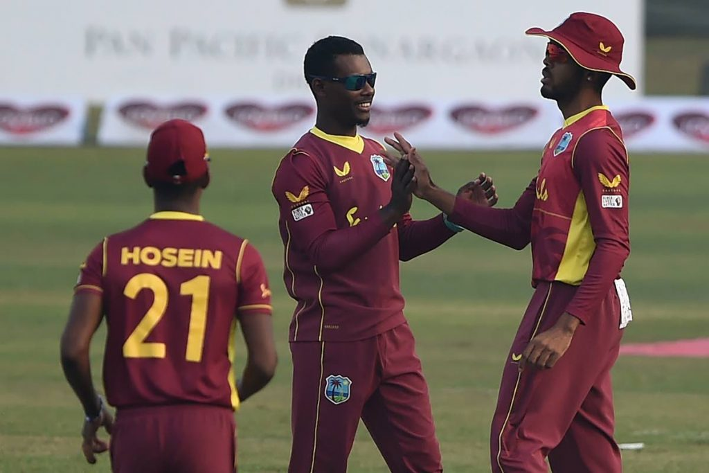 West Indies' captain Jason Mohammed (centre) celebrates with teammates Kjorn Ottley (right) and Akeal Hosein after the dismissal of Bangladesh's Najmul Hossain Shanto (not pictured) during the second ODI between Bangladesh and West Indies at the Sher-e-Bangla National Cricket Stadium in Dhaka on Friday. (AFP PHOTO) -