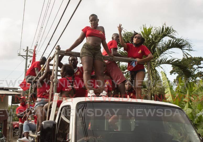 PNM supporters on a  truck during a motorcade on Sunday. PHOTO BY JEFF K MAYERS -