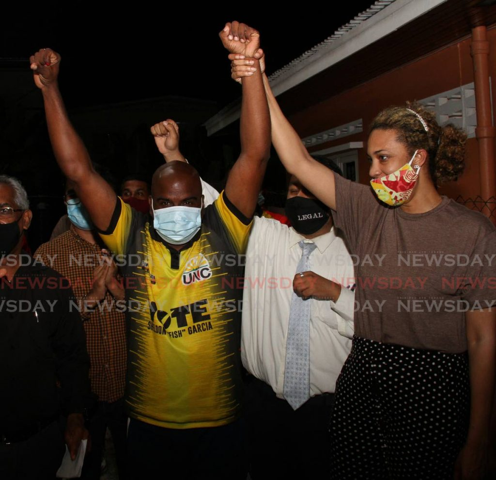 UNC's Sheldon 'Fish' Garcia, raises his hands in victory after being declared winner of the Arima Central seat in Monday's local government by-election. - Angelo Marcelle