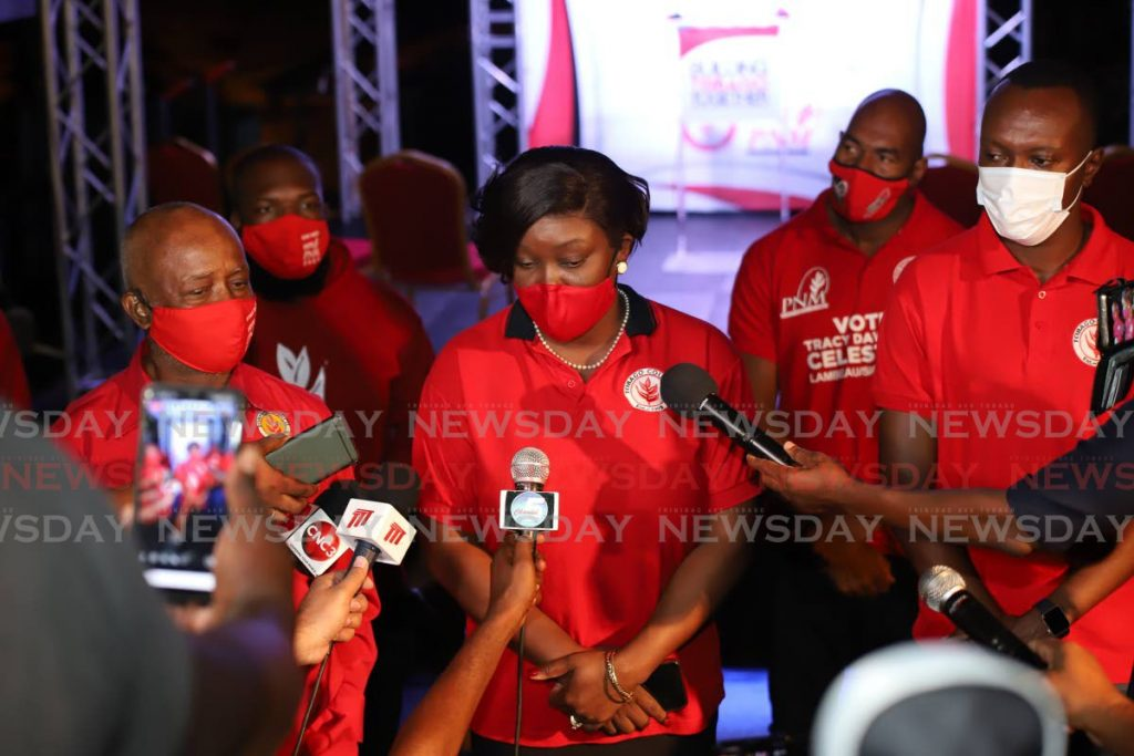 PNM Tobago Council leader Tracy Davidson-Celestine, centre, declares six seats for her party at PNM election headquarters in Scarborough on Monday evening. She is flanked by PNM Tobago Council chairman Stanford Callender, left, and Chief Secretary  Ancil Dennis. PHOTO BY JEFF K MAYERS -