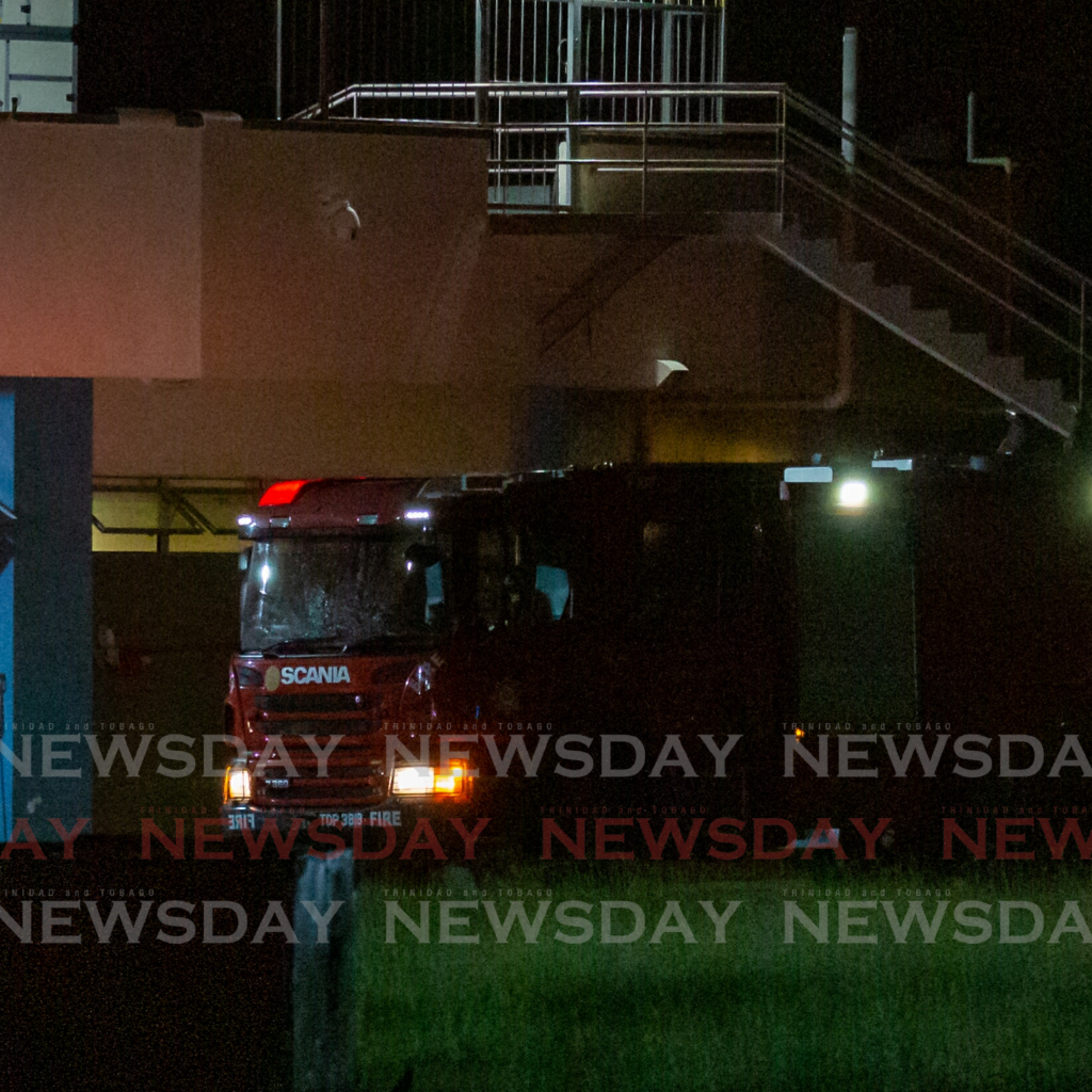 Fire officers at the scene of Tuesday night's blaze at Gulf City Mall, Lowlands, Tobago. Photo David Reid