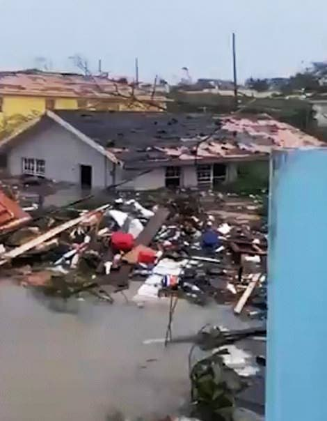A house in Abaco, Bahamas is surrounded by flood water and debris following the passage of Hurricane Dorian in 2019. -  PHOTO COURTESY LATRAE RAHMING/TWITTER
