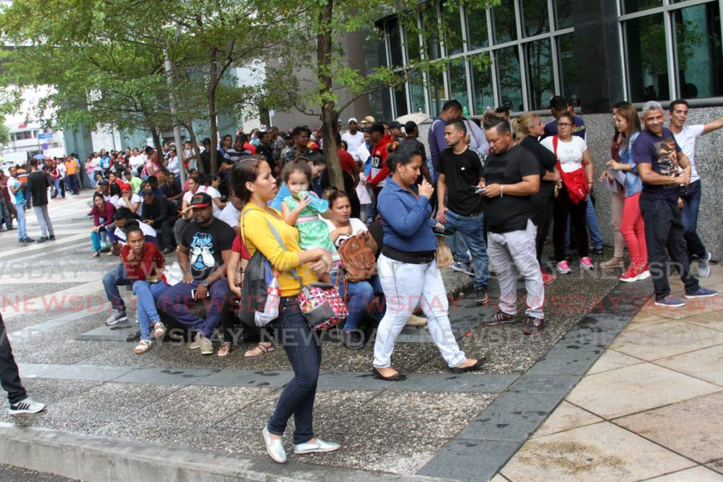 Venezuelan immigrants line up outside the Immigration Division, Ministry of National Security, Port of Spain on January 13, 2020. File photo -