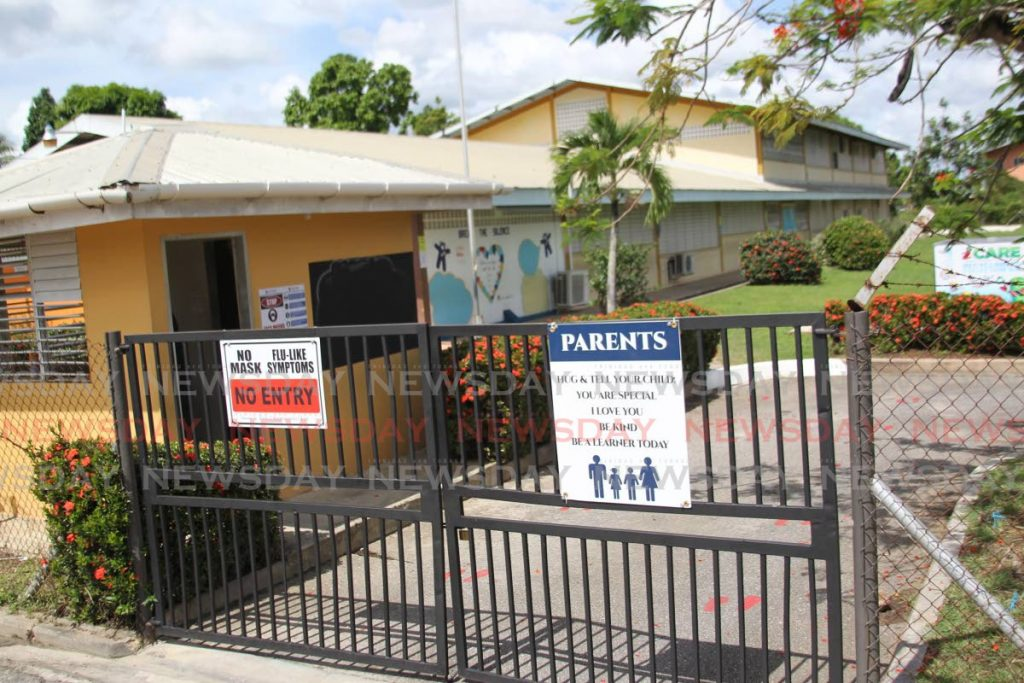 A sign on the compound of St Augustine South Government Primary School states visitors must wear masks. The Education Ministry has sent up a health unit to help mointor the safe reopening of schools starting with secondary schools on February 8. File photo -