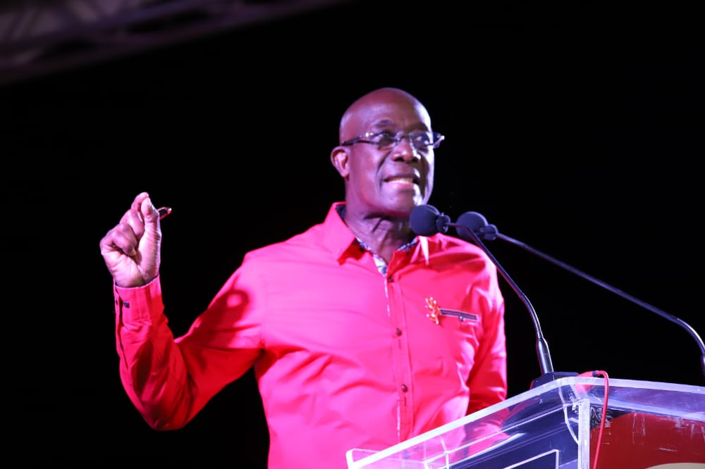 Prime Minister Dr Keith Rowley addresses the PNM meeting at Cyd Gray Complex, Roxborough on Wednesday evening. PHOTO BY JEFF MAYERS