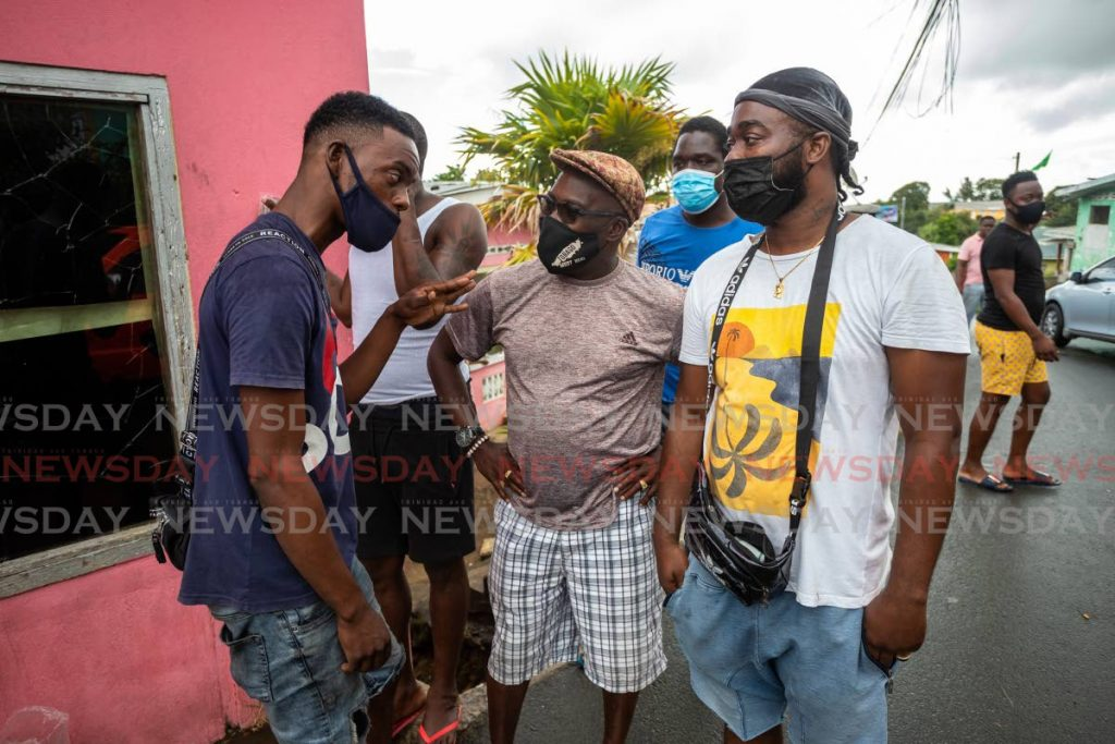 PDP assemblyman for Bethel/Mt Irvine Terance Baynes, centre, chats with residents during a walkabout after winning the seat in the THA election last Monday. PHOTO BY JEFF K MAYERS -