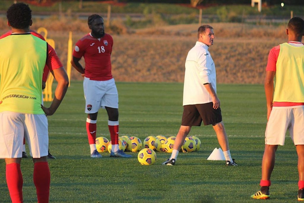 TT men's football team coach Terry Fenwick (centre) gives instructions during a training session at Orlando, Florida, US. PHOTO COURTESY TTFA. -