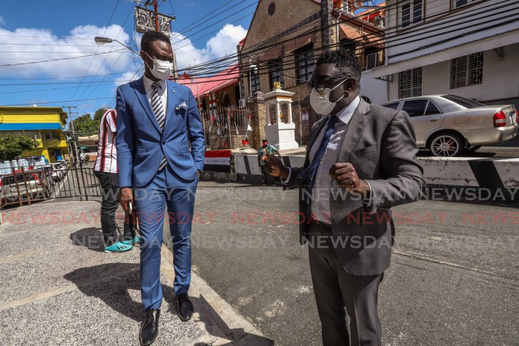 PDP deputy political leader Farley Augustine, left, political leader Watson Duke outside the Tobago House of Assembly after an overnight sit-in at the legislature in Scarborough on February 2. File photo -