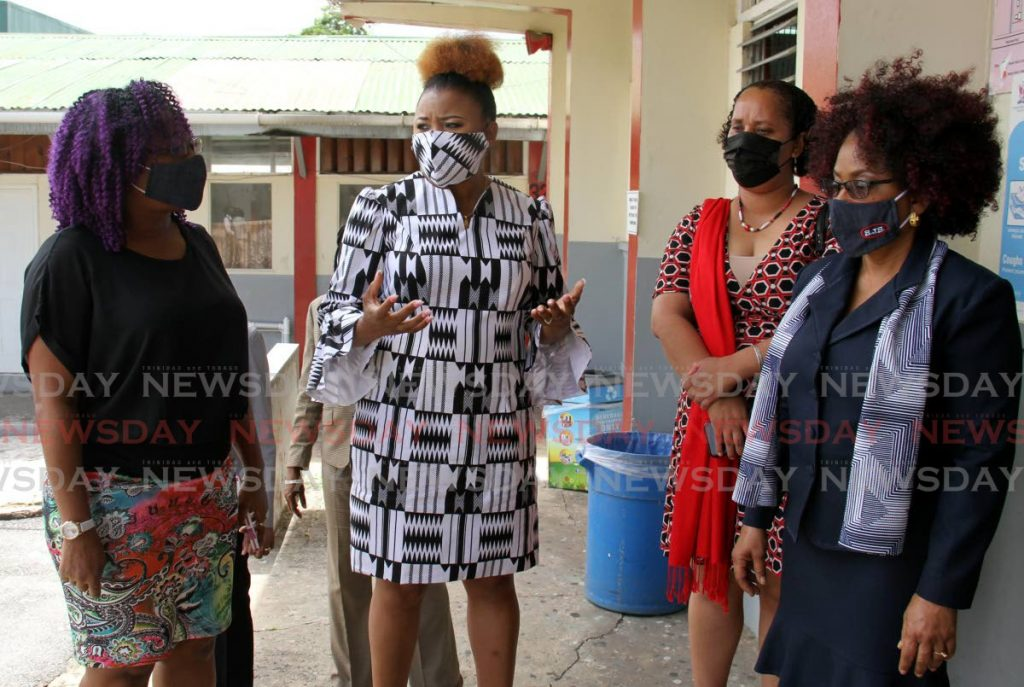 Education Minister Dr Nyan Gadsby-Dolly speaks with, from left, principal of St James Secondary School Rae-Ann Chase-Jackman, Minister in the Ministry of Education Lisa Morris-Julian and vice principal Carolyn Byer on Monday. - Ayanna Kinsale