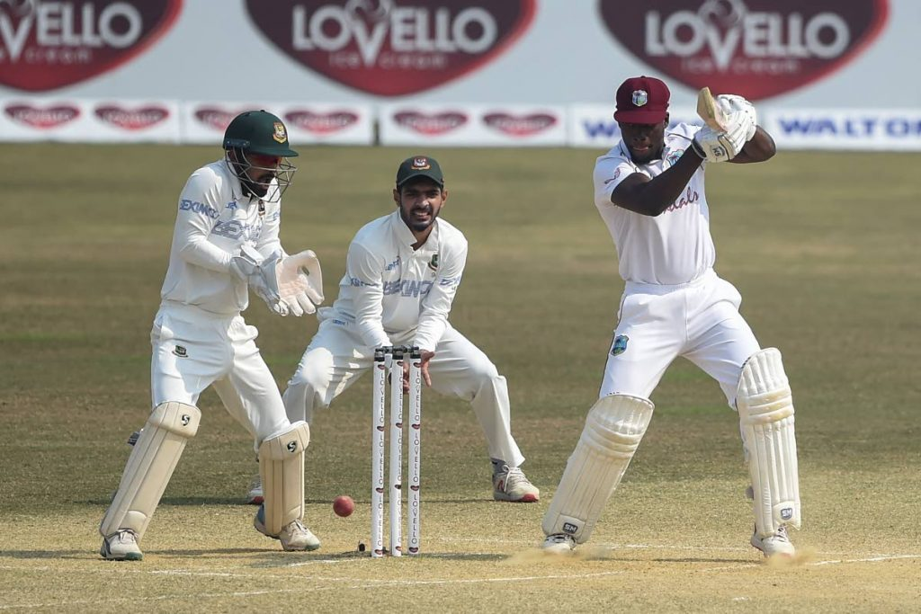 In this photo taken on Feb 7, West Indies' Nkrumah Bonner (R) plays a shot during the fifth day of the first cricket Test match against Bangladesh, at the Zohur Ahmed Chowdhury Stadium in Chittagong on Sunday.  - (AFP PHOTO)