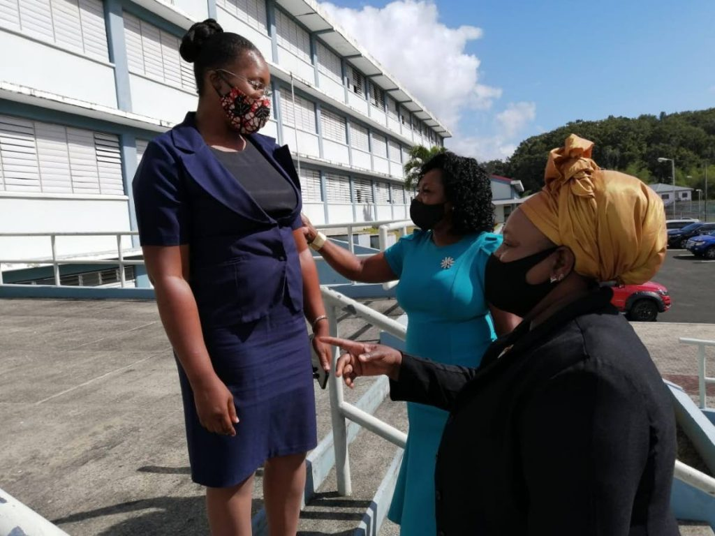 THA Secretary of Education, Innovation and Energy Marslyn Melville-Jack, centre, and school supervisor III Sherry-Ann Rollocks-Hackett speak to the principal of the Mason Hall Secondary School Suanne Demas on Monday before a tour of the school. PHOTO COURTESY THA -