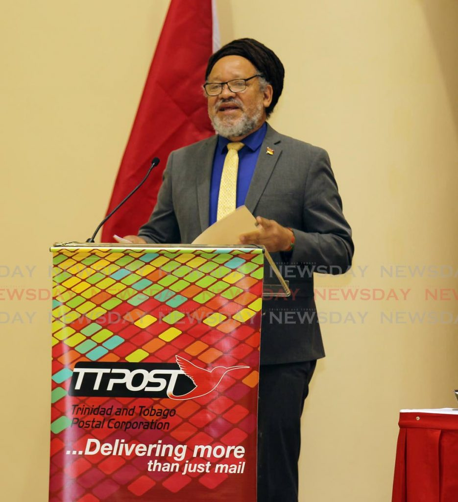 Couva/Tabaquite/Talparo Regional Corporation chairman Henry Awong speaks at the launch of the postal code project at the Couva Community Centre on Tuesday. PHOTO BY LINCOLN HOLDER -