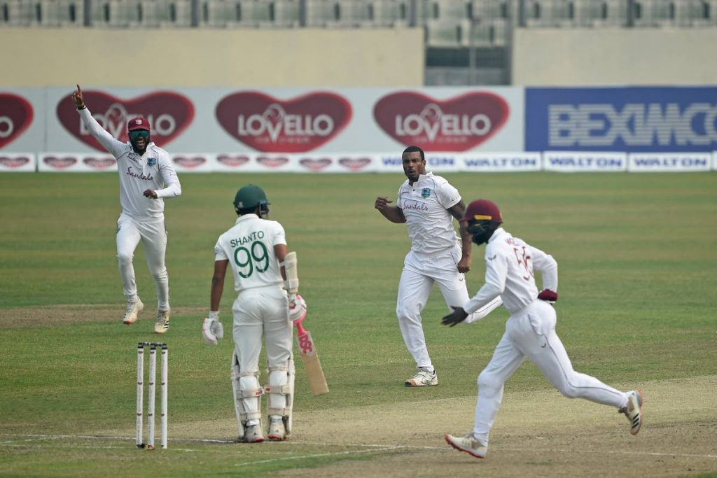 West Indies' cricketers celebrate the dismissal of Bangladesh's Najmul Hossain Shanto on day two of the second Test at the Sher-e-Bangla National Cricket Stadium in Dhaka on Friday. - AFP