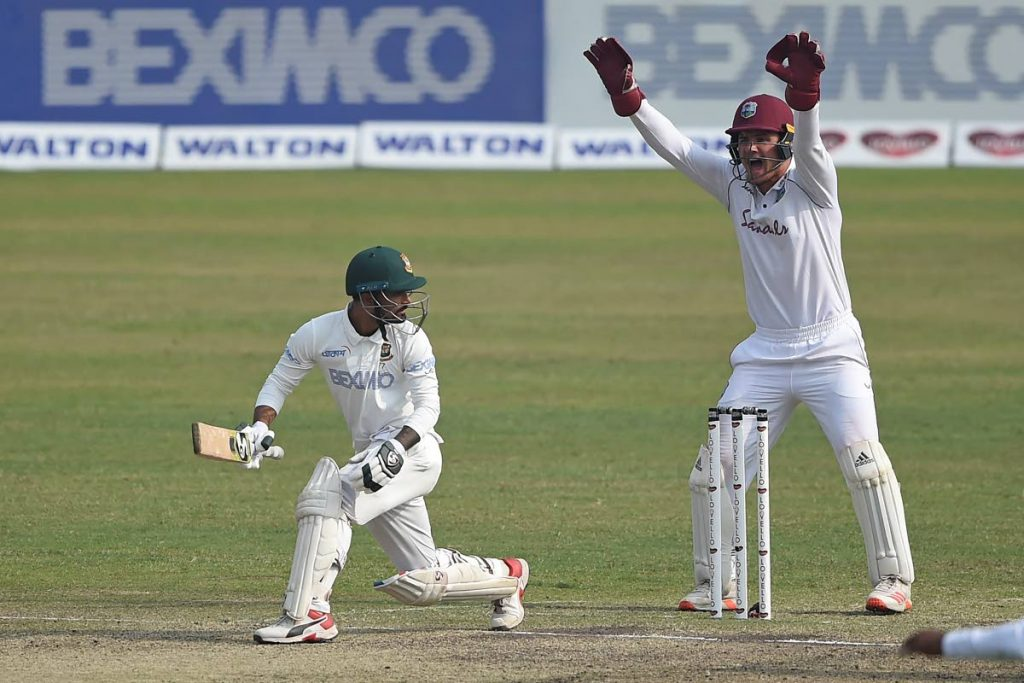 West Indies' wicketkeeper Joshua Da Silva (R) successfully appeals for the dismissal of Bangladesh's Liton Das during the third day of the second Test at the Sher-e-Bangla National Cricket Stadium in Dhaka,on Saturday. - (AFP PHOTO)