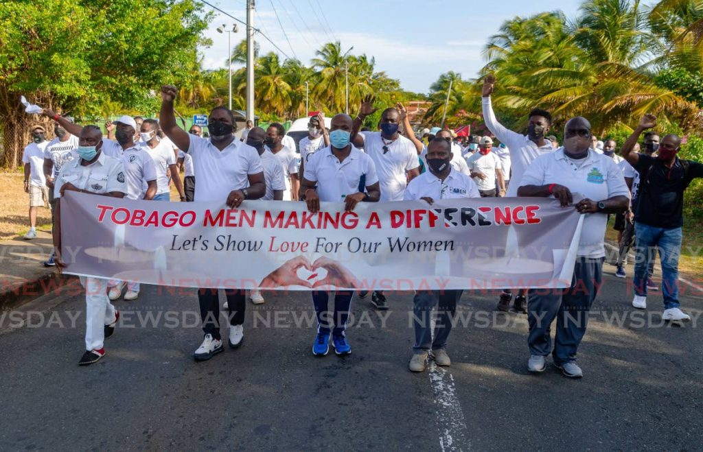 Men lead the way in the Tobago Men Making A Difference march to end violence against women in Crown Point on February 13. Gender experts say TT's male-dominated culture must change to include acceptance of women's rights. File photo -