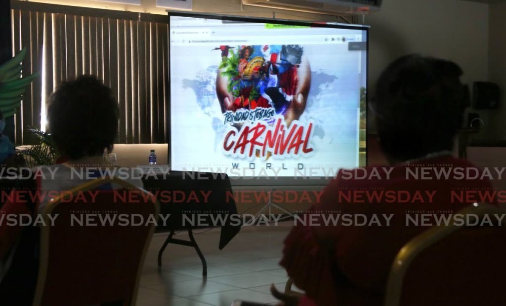 Invited guests get a glimpse of the TT Carnival World online platform during the National Carnival Commission launch of its latest project at the VIP lounge, Queen's Park Savannah, Port of Spain. - SUREASH CHOLAI  - 12806092 1024x620 - NCC launches virtual Carnival space