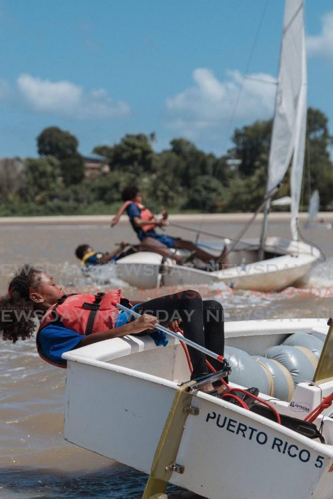 Young sailors of the Andrew Lewis Sailing Foundation get some time on the water at Vessigny Beach recently. - Melvern Isaac