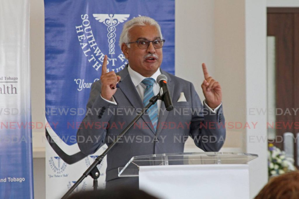 Health Minister Terrence Deyalsingh speaks at Wednesday's historic event to vaccinate frontline workers at the Couva hospital.  PHOTO BY MARVIN HAMILTON -