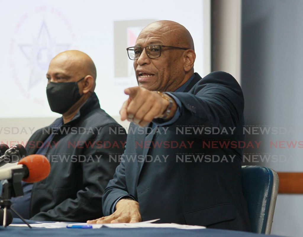 OWTU president general and Patriotic's chairman Ancel Roget responds to Finance Minister Colm Imbert at a news conference held at Paramount Building in San Fernando on Friday. - ROGER JACOB