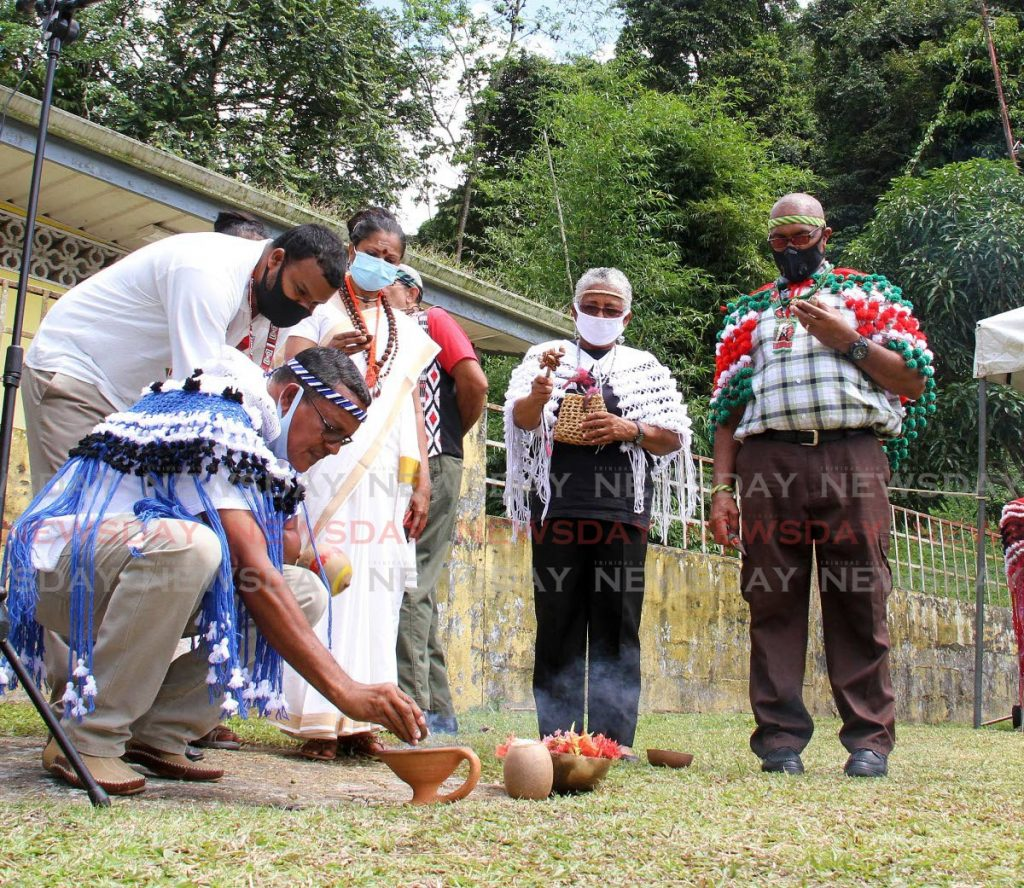 Chief Ricardo Bharath Hernandez of the Santa Rosa First Peoples Community, left, and other participants during a spritual healing ceremony at Heights of Aripo on Saturday. - Angelo Marcelle
