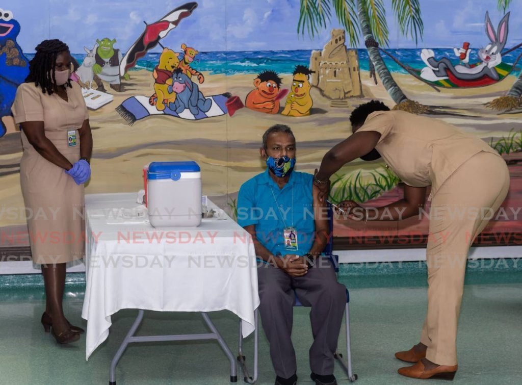Dr Ian Sammy receives his covid19 vaccine at the Scarborough Health Centre, in Bacolet, Tobago on Saturday. PHOTO BY DAVID REID -