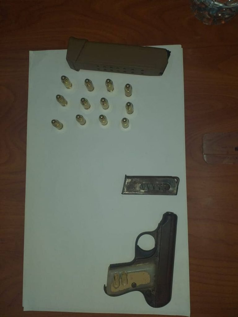 A pistol with 12 rounds of ammunition were seized by police in Brunton Lane, Mt Hope, early on Sunday morning.   PHOTO COURTESY TTPS - PHOTO COURTESY TTPS