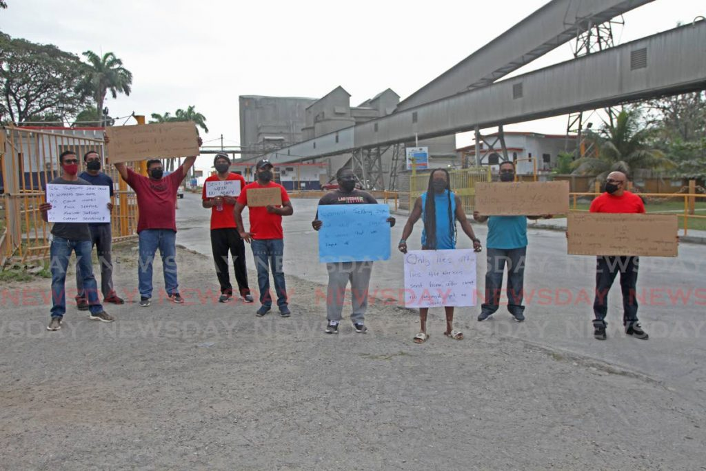 Retrenched workers including, (fourth from right) Nigel Ifill, Senior Operator at Packaging, Trinidad Cement Limited, held a protest at the company's carpark on Monday morning. Photos by Marvin Hamilton