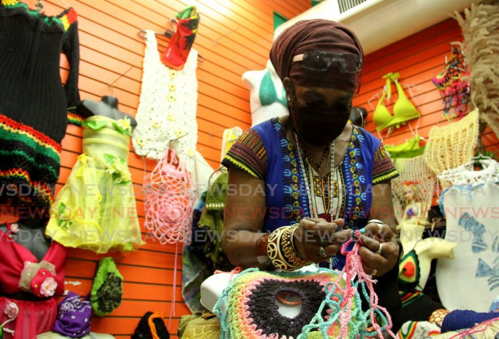 Lucia Joseph of Cias Fashion Designs does some crochet at her store on George Street, Port of Spain - AYANNA KINSALE