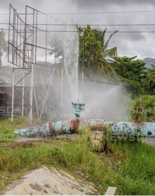 In this December 2018 file photo, a broken water main spews gallons of water down the drain off Beetham Highway, Port of Spain. - JEFF MAYERS