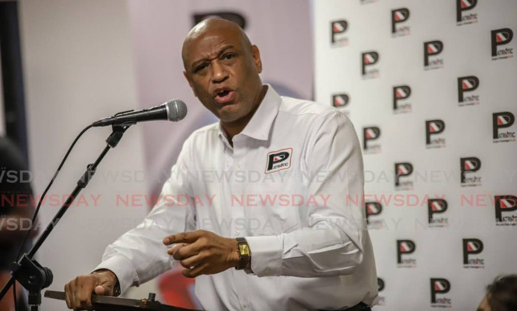 OWTU president general Ancel Roget unveils the logo of Patriotic Energies and Technologies Co Ltd, owned by the trade union, at Radisson Hotel, Port of Spain on November 15, 2019.  A week ago, Government rejected Patriotic's bid for the refinery a third time. File photo  -