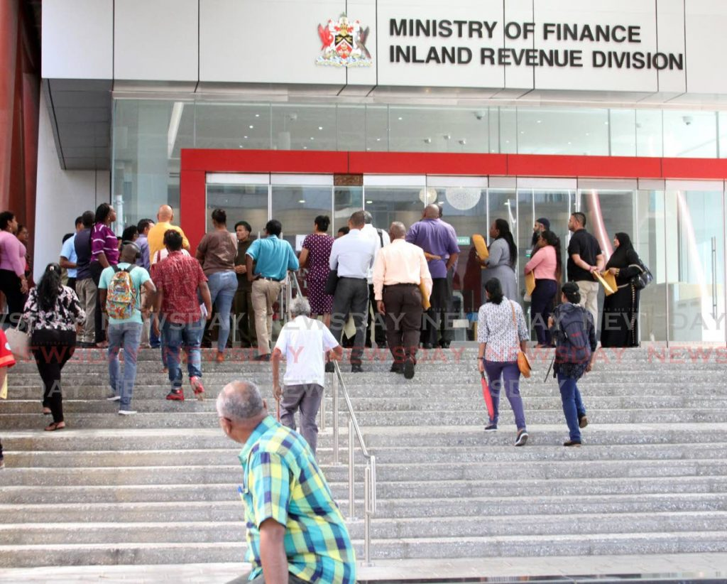 Members of the public wait to enter the Inland Revenue Division, Government Plaza, Port of Spain. File photo -