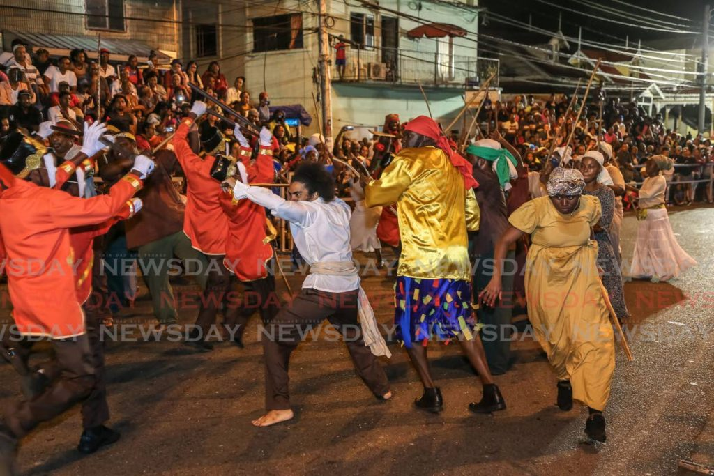 Canboulay re-enactment on February 21, 2020,  on Piccaddily  Street, Port of Spain. -