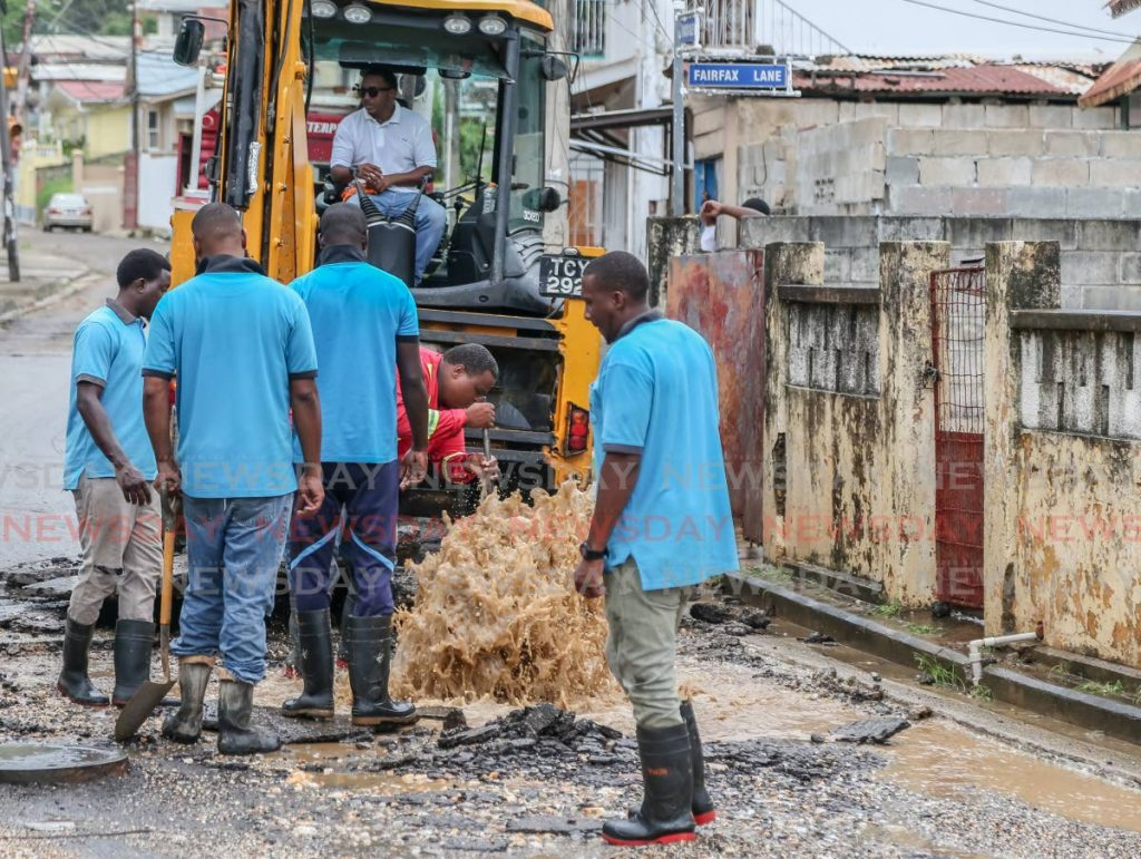 In this file photo, WASA workers on the job in Belmont repairing a broken water main. - Jeff Mayers