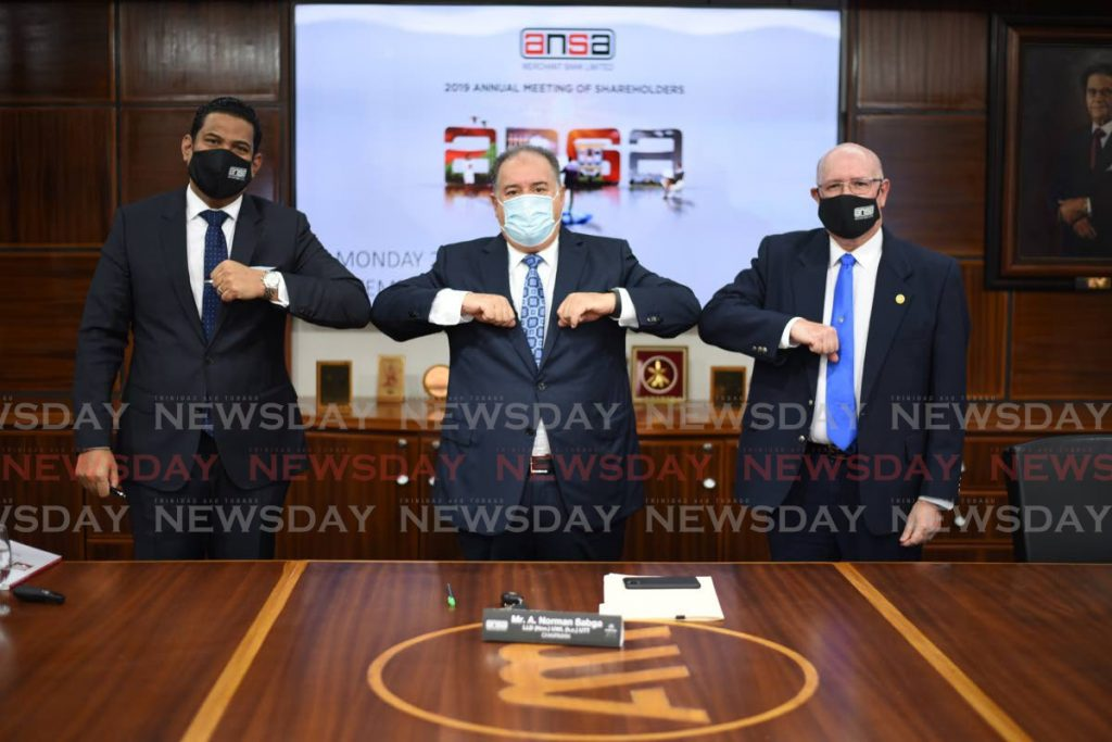 ANSA Merchant Bank chairman A Norman Sabga (centre) knocks elbows with managing director Gregory Hill (left) and corporate secretary Robert Ferreira at the 2019 annual meeting of shareholders, held virtually on September 28, 2020. In its 2020 financials, the bank reported a $152 million decline in income. -