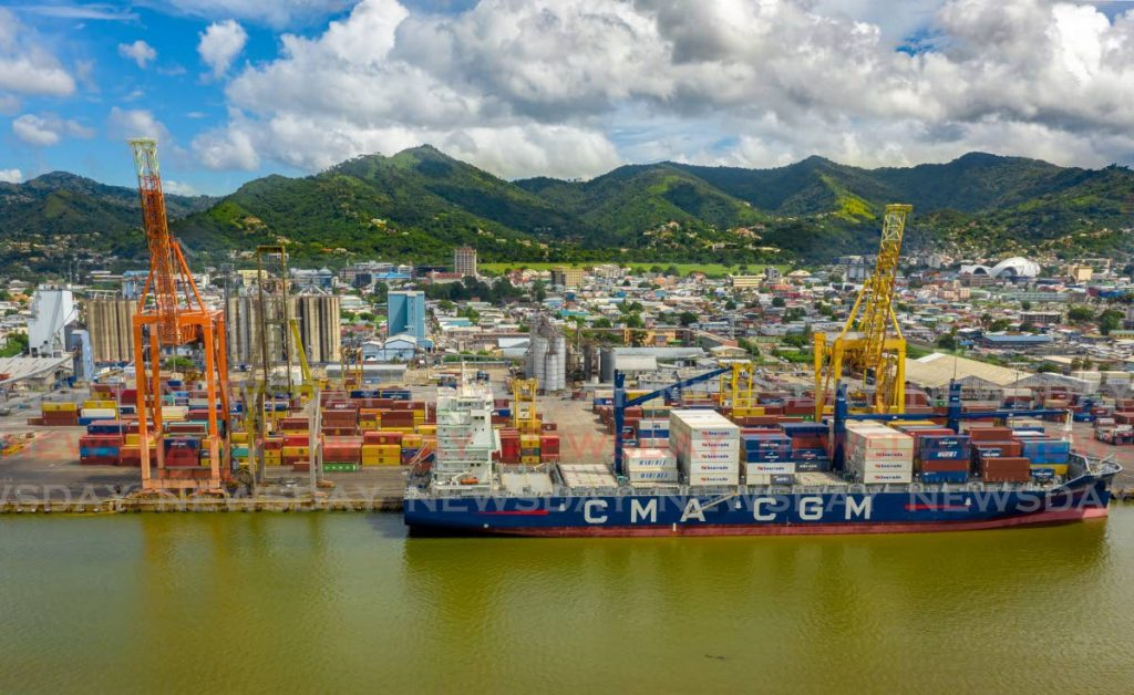 A cargo ship docked at the Port of Port of Spain. Recent changes to the method of releasing containers caught many port users unawares.   File Photo
