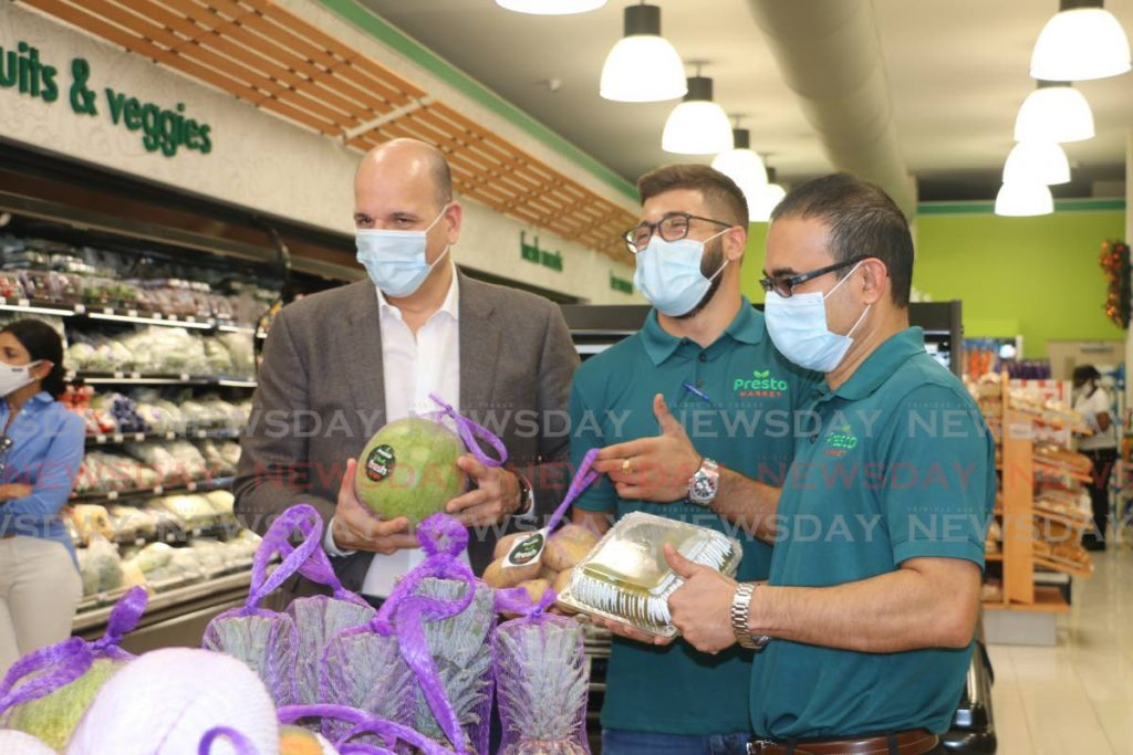 Agostini Group chairman Christian Mouttet, left, at the launch of fresh produce at the Presto Market in Trincity. Alongside Mouttet are SuperPharm business development representative Jean-Luc Mouttet and SuperPharm CEO Glen Maharaj in December 2020. SuperPharm is part of the Agostini Group which has acquired pharmaceutical companies Oscar Francois Ltd and Intersol Ltd. File photo -