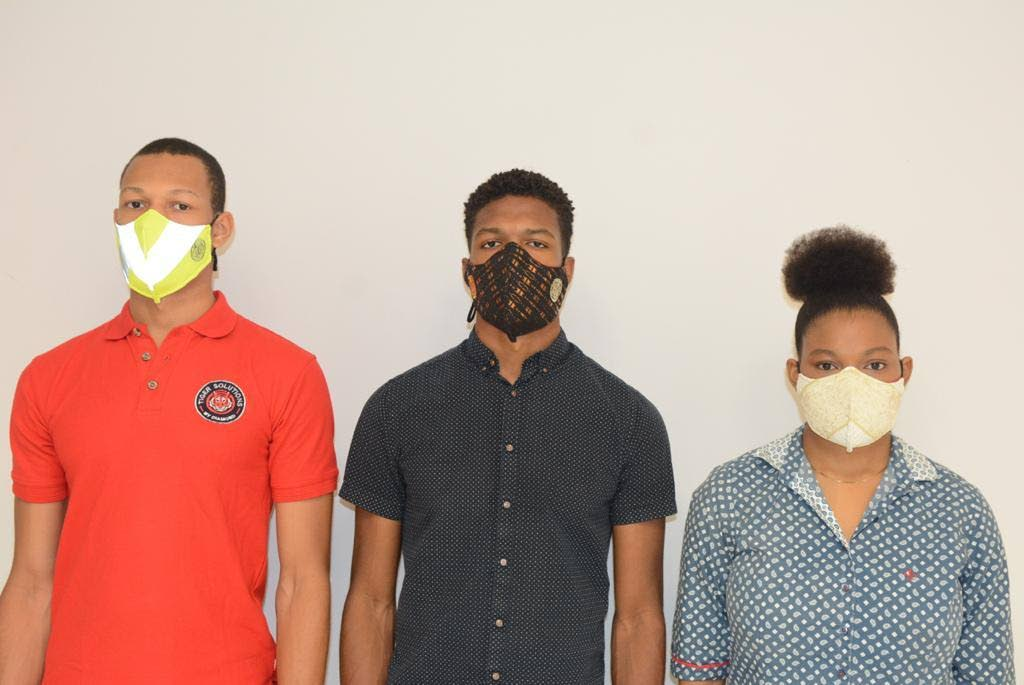 Elijah, left, Joshua and Cianna Riley created a face mask that has a safety certification from Cariri.    -